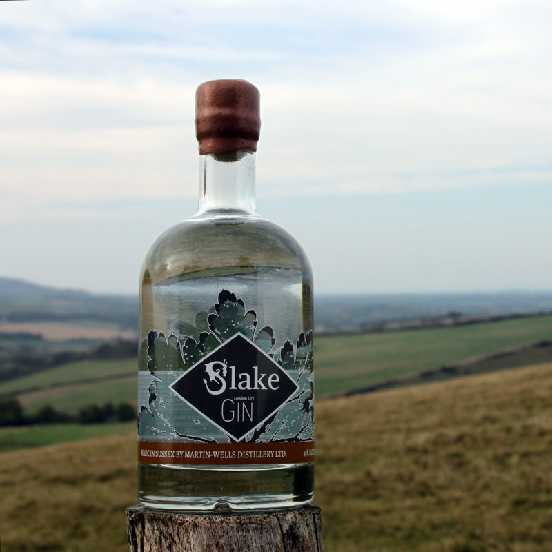 A fine bottle of Slake Spirits Sussex Dry Gin pictured on Mill Hill in the South Downs