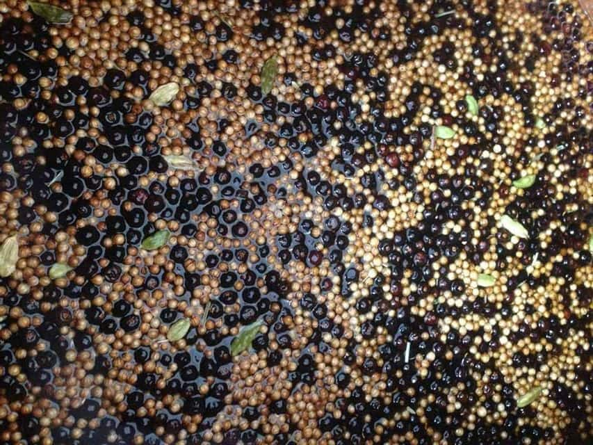 Juniper Berries and gin botanicals steeping in alcohol ready for distillation