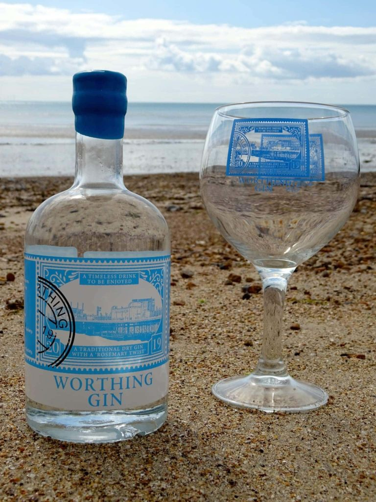 A bottle of Worthing Gin at the beach
