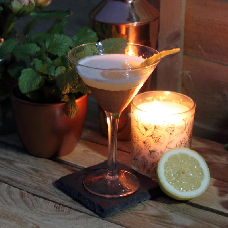 Slake Gin Bee's Knees cocktail in martini glass with lemon slip garnish