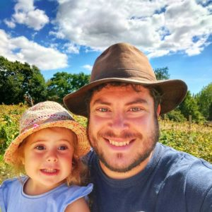 Slake's distiller, Tom and his daughter Mabel picking raspberries together.